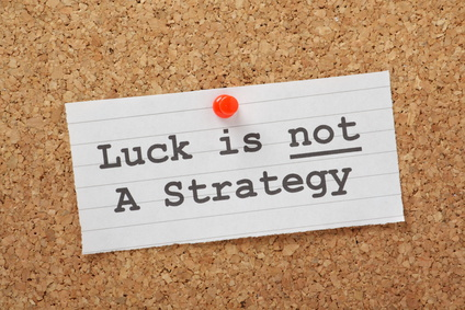 Luck is not a Strategy on a cork notice board as a reminder